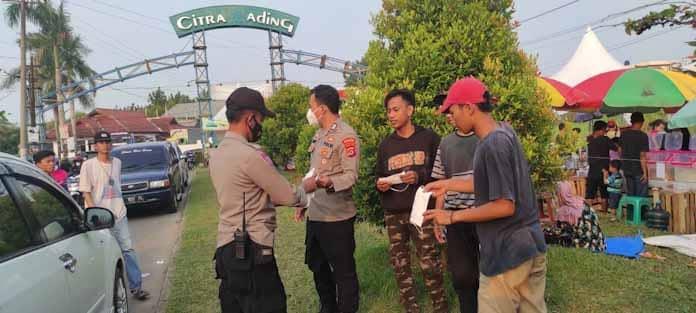 Jelang Buka Puasa, Polsek Cipocok Jaya Gencar Himbau Protkes dan Bagikan Ratusan Masker